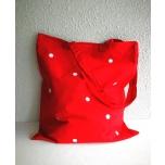 Punane riidest kott väikeste täppidega