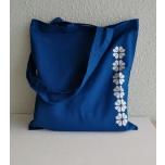 Sinine riidest kott kindakirjaga