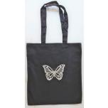 Väike riidest must kott hõbedase liblikaga