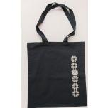 Must riidest kott kindakirjaga