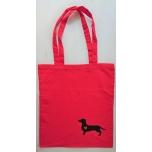 Väike riidest punane kott musta koeraga