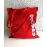 Punane riidest kott kindakirjaga