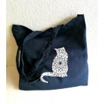 Tumesinine riidest kott Mustriline kass