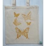 Väike orgaaniline tekstiilkott kuldsete liblikatega