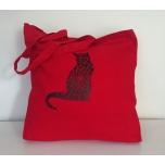 Punane riidest kott Mustriline kass