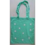 Väike riidest mündiroheline kott valgete täppidega